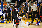 Houston Rockets forward Montrezl Harrell (5) dunks over Golden State Warriors forward James Michael McAdoo (20) at Oracle Arena in Oakland, Calif., on December 1, 2016. (Stan Olszewski/Special to S.F. Examiner)