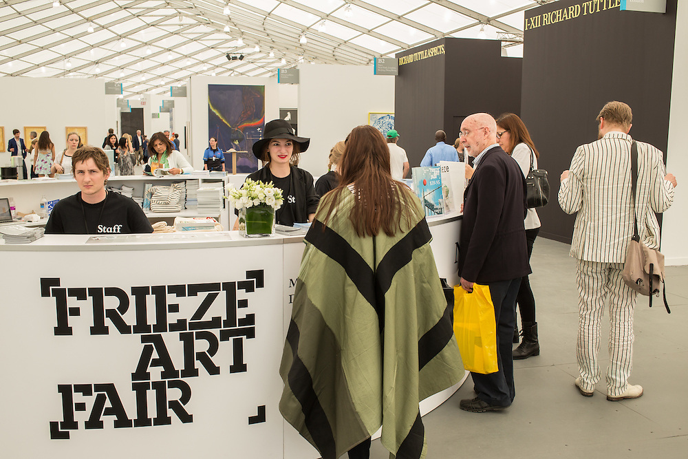 Visitors come to the information book at the Frieze Art Fair. A total of 190 galleries exhibited at the fairr, 63 of which were from New York City.