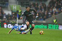 Football - 2017 / 2018 Premier League - Brighton and Hove Albion vs. Chelsea<br /> <br /> Eden Hazard of Chelsea skips over the challenge of Pascal Gross of Brighton at The Amex Stadium Brighton <br /> <br /> COLORSPORT/SHAUN BOGGUST