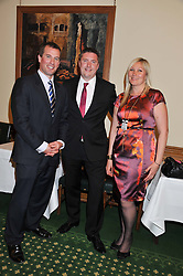 Left to right, PETER PHILLIPS and WILL & CARO GREENWOOD at a reception for The Mirela Fund in partnership with Hope and Homes for Children hosted by Natalie Pinkham in The Churchill Room, House of Commons, London on 30th April 2013.