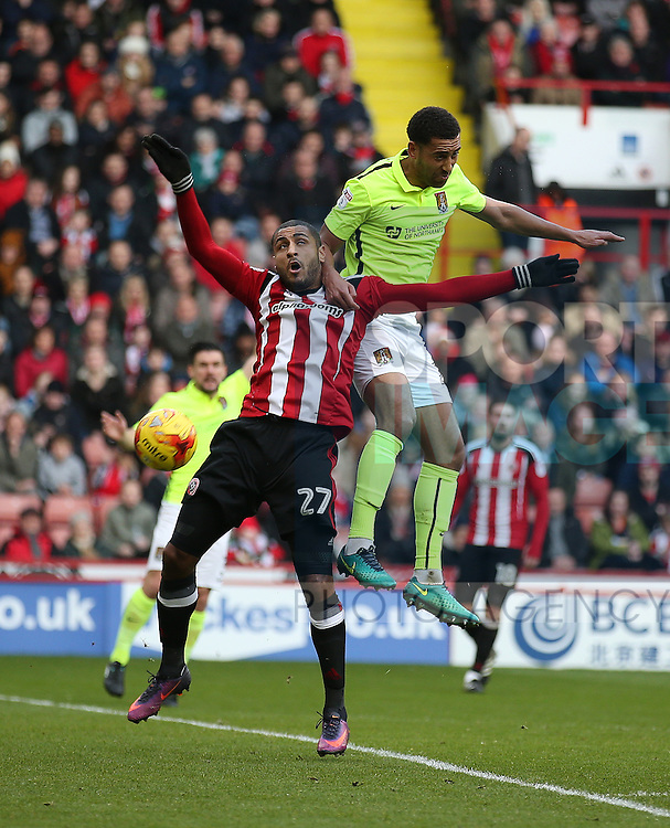 Leon Clarke of Sheffield Utd tussles with Lewin Nyatenga of Northampton during the English League One match at Bramall Lane Stadium, Sheffield. Picture date: December 31st, 2016. Pic Simon Bellis/Sportimage