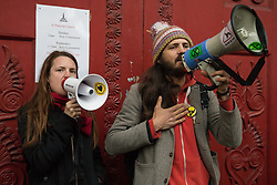 London, UK. 5th May, 2021. Two environmental activists, including Marcus Carambola (r), sing to environmental campaigners outside St Pancras Church during a March On The Motorway event organised by Burning Pink to coincide with the eve of the London Mayoral election. Burning Pink is a radical political party campaigning for rapid action to combat the climate emergency through the setting up of citizens assemblies.
