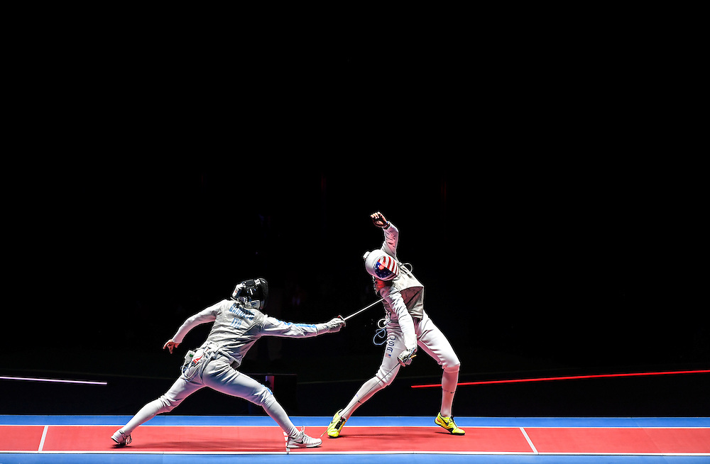 United States men's foil fencer Alexander Massialas, right, was touched for a point in the gold medal match Sunday by Daniele Garozzo of Italy, left, at the 2016 Summer Olympics Games in Rio de Janeiro, Brazil. Garozzo won the match and the gold medal, 15-11.