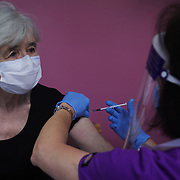 An elderly local woman gets her first AstraZeneca jab at Stow Health Clinic on the 30th of January 2021, Stow,Scottish Borders, United Kingdom. Scotland has been allocated an initial 500.000 doses of the Oxford vaccine and vaccination was rolled out across the country throughout January.