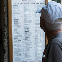 Venice August 20 A tourist look at the Lavena Menu. A group of Italian tourists were horrified to be charged the equivalent of £85 for four espresso coffees laced with liqueurs in the very central Saint Mark's Square in  Venice.