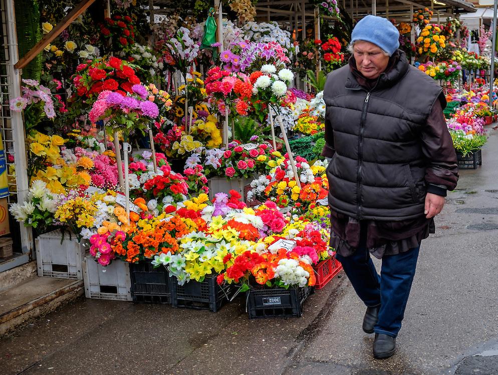 RIGA, LATVIA - CIRCA MAY 2014: Person walking in the exterior area of the Central Market in Riga