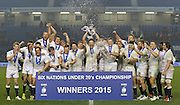 England players celebrate winning the trophy during the Under 20s Six Nations Championship match between England and France at the American Express Community Stadium, Brighton and Hove, England on 20 March 2015. Photo by Phil Duncan.