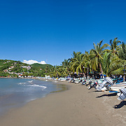 Fishing boats on the beach at Zihuatanejo, Mexico. High resolution panorama.