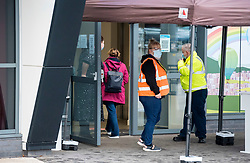 © Licensed to London News Pictures; 11/01/2021; Bristol, UK. The first people arrive at the vaccine hub at Ashton Gate stadium which opens today during the Covid-19 coronavirus pandemic in England. The hub in the South Stand of the stadium, which is home to Bristol City FC and Bristol Bears RFC, is one of seven major vaccine hubs opening today around the UK to be used for the mass vaccinations against the Covid-19 coronavirus, part of the drive to vaccinate as many vulnerable people as possible as the new variant of coronavirus spreads across the UK. The UK is now under a third national lockdown to try and restrict the spread of Covid-19 after a new strain of a more infectious Covid virus was detected late last year.is one of seven major vaccine hubs across the country. Photo credit: Simon Chapman/LNP.
