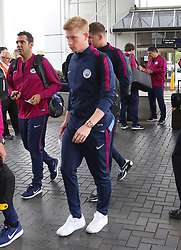 Kevin DeBruyne as the Manchester City team arrive at Manchester Airport as they jet for Iceland