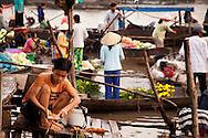 A teenage boy peels carrots as the chaos of the morning floating market unfolds around him. He is working on a small pier that connects to his small family house on the Mekong River. Robert Dodge, a Washington DC photographer and writer, has been working on his Vietnam Unexpected project since 2005. The project has taken him throughout Vietnam, including Hanoi, Ho Chi Minh City (Saigon), Nha Trang, Mue Nie, Phan Thiet, the Mekong, Sapa, Ninh Binh and the Perfume Pagoda. His images capture scenes and people from women in conical hats planting rice along the Red River in the north to men and women working in the floating markets one the Mekong River and its tributaries. Robert's project also captures the traditions of ancient Asia in the rural markets, Buddhist Monasteries and the celebrations around Tet, the Lunar New Year. Also to be found are images of the emerging modern Vietnam, such as young people eating and drinking and embracing the fashions and music of the west. Robert Dodge, a Washington DC photographer and writer, has been working on his Vietnam Unexpected project since 2005. The project has taken him throughout Vietnam, including Hanoi, Ho Chi Minh City (Saigon), Nha Trang, Mue Nie, Phan Thiet, the Mekong, Sapa, Ninh Binh and the Perfume Pagoda. His images capture scenes and people from women in conical hats planting rice along the Red River in the north to men and women working in the floating markets one the Mekong River and its tributaries. Robert's project also captures the traditions of ancient Asia in the rural markets, Buddhist Monasteries and the celebrations around Tet, the Lunar New Year. Also to be found are images of the emerging modern Vietnam, such as young people eating and drinking and embracing the fashions and music of the West.