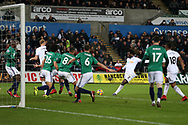 Wilfried Bony of Swansea city © shoots and scores his teams 1st goal to make it 1-0. Premier league match, Swansea city v West Bromwich Albion at the Liberty Stadium in Swansea, South Wales on Saturday 9th December 2017.<br /> pic by  Andrew Orchard, Andrew Orchard sports photography.