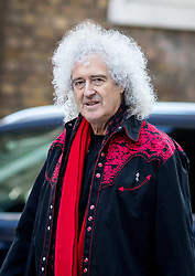 © Licensed to London News Pictures. 26/03/2018. London, UK. Queen guitarist Brian May arrives with campaigners in Downing Street to deliver a petition calling for British Prime Minister Theresa May to introduce a UK animal-fur import ban. The petition, partly organised by PETA, has gained 400,000 signatures. Photo credit : Tom Nicholson/LNP
