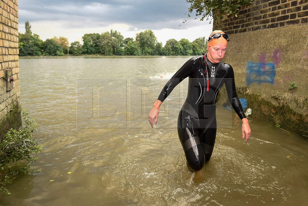 © Licensed to London News Pictures. 31/08/2018. LONDON, UK.  A participant completes the Thames River Swim as part of Totally Thames 2018.  Swimmers set off on a circular route from Hammersmith and around Chiswick Eyot, approximately 1500m.  Photo credit: Stephen Chung/LNP