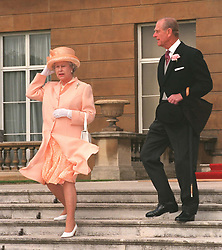 File photo dated 21/07/98 of Queen Elizabeth II and the Duke of Edinburgh descending the steps of Buckingham Palace at a garden party. The Royal couple will celebrate their platinum wedding anniversary on November 20.
