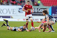 Aled Davies of the Scarlets is tackled by Sam Warburton of the Cardiff Blues (on ground) and Josh Navidi (6).. Rabodirect Pro12 rugby, Scarlets v Cardiff Blues at the Parc y Scarlets in Llanelli, South Wales on Saturday 20th April 2013. pic by Andrew Orchard,  Andrew Orchard sports photography,