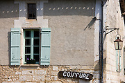 Coiffure in quaint town of Bourdeilles popular tourist destination near Brantome in Northern Dordogne, France