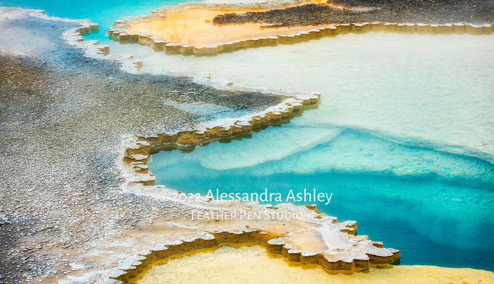 Abstract shapes, colors and patterns of Doublet geothermal pool, Yellowstone National Park, Wyoming.
