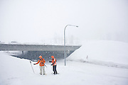 A pair of snowshoers gear up for a hike into Commonwealth Basin off the I-90 highway overpass at Snoqualmie Pass, Washington on January 26, 2008.