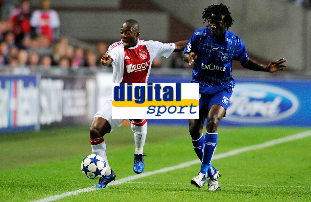 FOOTBALL - CHAMPIONS LEAGUE 2010/2011 - GROUP STAGE - GROUP G - AJAX AMSTERDAM v AJ AUXERRE - 19/10/2010 - PHOTO GUY JEFFROY / DPPI - EYONG ENOH (AJAX) / KEVIN NDINGA (AUX)