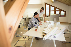 Architects discussing about project in the office, Bavaria, Germany