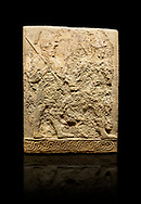 Hittite sculpted orthostats panels of Long Wall Limestone, Karkamıs, (Kargamıs), Carchemish (Karkemish), 900-700 B.C. Soldiers. Anatolian Civilisations Museum, Ankara, Turkey<br /> <br /> Figure of two helmeted warriors. They have their shield in their back and their spear in their hand. The prisoner in their front is depicted as small. The lower part of the orthostat is decorated with braiding motifs. <br /> <br /> On a black background. .<br />  <br /> If you prefer to buy from our ALAMY STOCK LIBRARY page at https://www.alamy.com/portfolio/paul-williams-funkystock/hittite-art-antiquities.html  - Type  Karkamıs in LOWER SEARCH WITHIN GALLERY box. Refine search by adding background colour, place, museum etc.<br /> <br /> Visit our HITTITE PHOTO COLLECTIONS for more photos to download or buy as wall art prints https://funkystock.photoshelter.com/gallery-collection/The-Hittites-Art-Artefacts-Antiquities-Historic-Sites-Pictures-Images-of/C0000NUBSMhSc3Oo