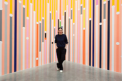 © Licensed to London News Pictures. 16/04/2019. London, UK. Artist Sarah Morris with her work titled 'What can be explained can also be predicted' (2019) showing as part of her exhibition  'Machines do not make us into Machines' exhibition at the White Cube gallery. Photo credit: Ray Tang/LNP