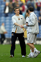 Photo: Jed Wee.<br />Burnley v Hull. Coca Cola Championship. 14/10/2006.<br /><br />A glum Hull manager Phil Parkinson (L) shakes hands at the end of the game.