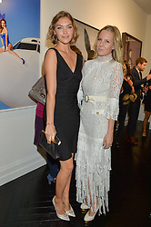 Left to right, ARIZONA MUSE and ALICE NAYLOR-LEYLAND at a party to celebrate the launch of the Maddox Gallery at 9 Maddox Street, London on 3rd December 2015.