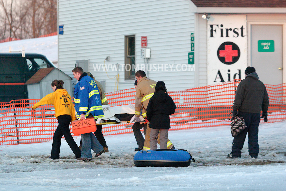 Hamptonburgh, NY - Firefighters and first responders carry a person injured on the tubing hill at Thomas Bull Memorial Park to a waiting ambulance on Feb. 16, 2008.