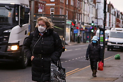 © Licensed to London News Pictures. 05/01/2021. London, UK. Women wearing protective face coverings in north London as England begins its third national lockdown. Prime Minister Boris Johnson announced on Monday 4 January 2021 that England goes into third national lockdown until at least 22 February 2021, with households ordered to stay home and only go outside for the specific reasons. Photo credit: Dinendra Haria/LNP