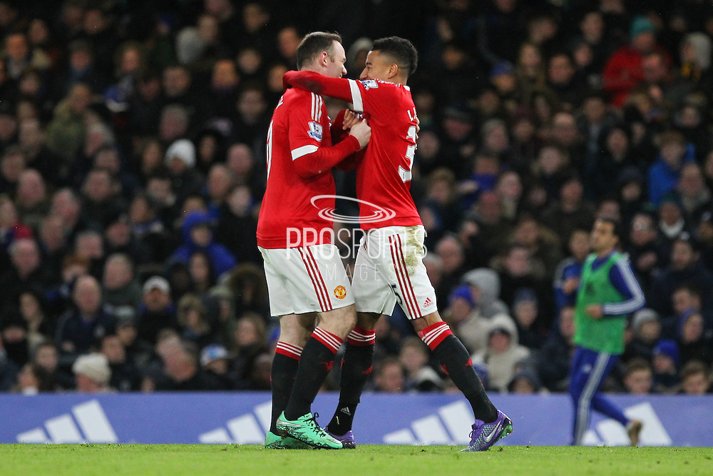 Jesse Lingard of Manchester United celebrates with Wayne Rooney of Manchester United his goal during the Barclays Premier League match between Chelsea and Manchester United at Stamford Bridge, London, England on 7 February 2016. Photo by Phil Duncan.