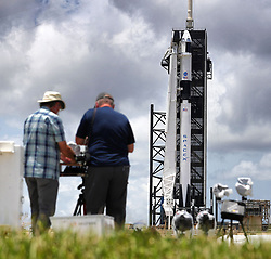 News photographers set up remote cameras as the Crew Dragon capsule sits on top of the SpaceX Falcon 9 rocket at Launch Complex 39-A at Kennedy Space Center, FL, USA, on Friday, May 29, 2020. The second launch attempt of the Demo-2 mission is scheduled for Saturday at 3:22pm. Photo by Joe Burbank/Orlando Sentinel/TNS/ABACAPRESS.COM