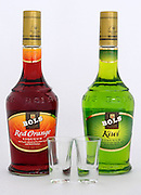 Two bottles of Bols liquor one red (red orange) and one green (Kiwi)