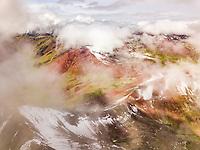 Aerial view of snowy, hazy Vinicunca, Rainbow Mountain, Peru.
