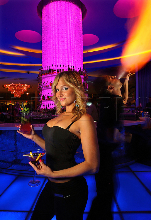 Bartender Kelley Marchette at the Fontainebleau Miami Beach with bartender and fire breather Hector Acevedo.
