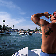 Partiers like Kyle Henderson descend on Lake Havasu, Arizona for the Memorial Day weekend. The lake attracts thousands of boaters and partiers every year during major holidays. This is Bridgewater Channel.