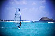 A windsurfer on the beautiful turquoise Caribbean Sea.
