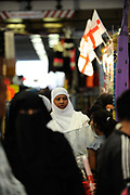 Asian women shop in a market in West Ham area of Newham, London.The borough has the second highest percentage of Muslims in Britain.