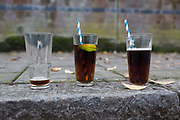 Three glasses, one empty and two almost full, have been left in the street, the morning after New Years Eve, on 1st January 2019, in south London, England.