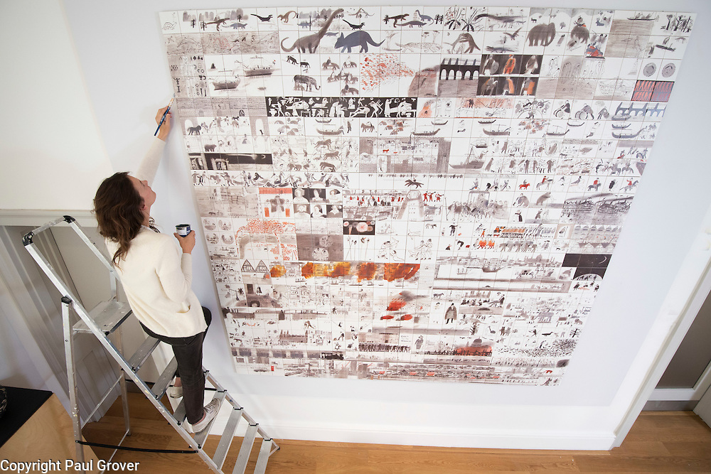 Mar0073093.DT News.House of Illustration.Award-winning illustrator Laura Carlin explores the power of ceramics and storytelling in her first major public exhibition<br /> In October 2016 House of Illustration will open the first major public exhibition by acclaimed illustrator Laura Carlin exploring the narrative possibilities of ceramics.<br /> In the exhibition Carlin uses archetypal ceramic forms such as the vessel, the tile, the object and the plate to explore ceramics and storytelling.<br /> It will include a 650-tile mural exploring the history of London which combines a narrative storytelling format, typically associated with ephemeral comics and zines, with the permanent solid form of the ceramic tile. There will also be an installation of 20 illustrated plates, a ceramic Noah's ark complete with animals, a theatrical installation with ceramic figurines and a large illustrated vessel.Pic Shows Caura Carlin putting the finishing touches to the 650 tile history of London mural