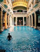 Man swimming in the pool at the famous Gellert Furdo, built between 1912 and 1918 in Budapest, Hungary