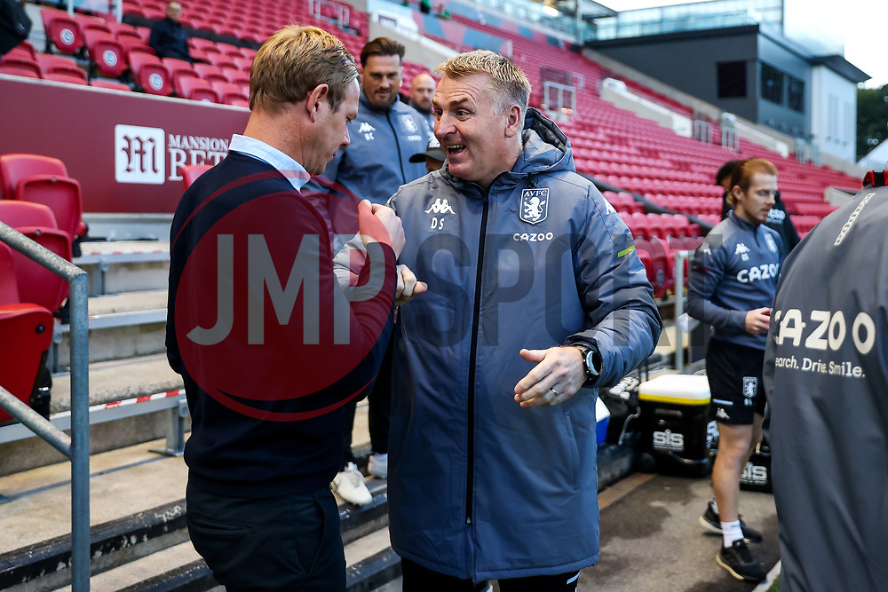 Bristol City head coach Dean Holden greets Aston Villa manager Dean Smith - Rogan/JMP - 24/09/2020 - Ashton Gate Stadium - Bristol, England - Bristol City v Aston Villa - Carabao Cup Third Round.