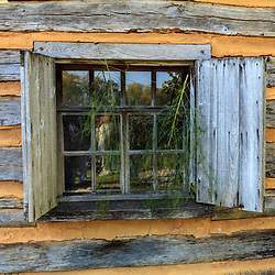 An old window in a log building.