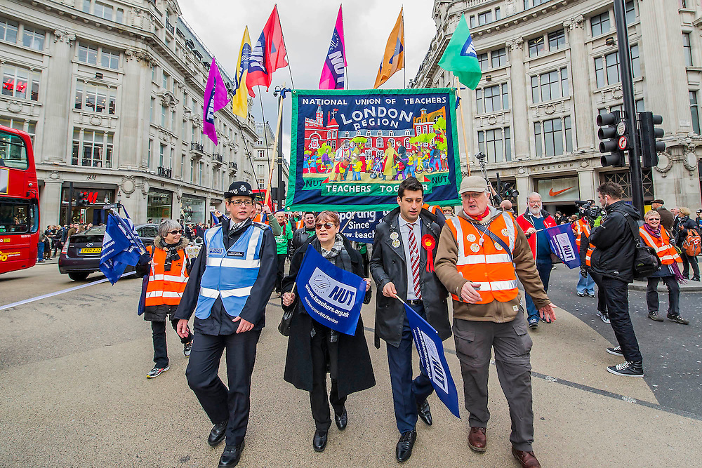 """The NUT leads a national strike action in England and Wales. Marches and rallies are being held around the country, including this one from Broadcasting House to Downing Street, Whitehall. The union says the action is being taken against: Excessive workload and bureaucratic; Performance related pay and in defence of a national pay scale system; Unfair pension changes. Christine Blower (pictured with sun glasses and with Laween Atroshi, with rosette, the Labour candidate who will stand against Michael Gove at the next election), General Secretary of the National Union of Teachers, the largest teachers' union said: """"Teachers deeply regret the disruption caused by this strike action to parents and teachers. The Government's refusal, however, to engage to resolve the dispute means that we have no alternative other than to demonstrate the seriousness of our concerns.<br /> """"Teachers' levels of workload are intolerable –the Government's own survey, published last month, shows that primary school teachers work nearly 60 hours a week and secondary school teachers work nearly 56 hours a week. 2 in 5 teachers are leaving the profession in the first 5 years of teaching as are many others.  This is bad for children and bad for education. London, UK 26 March 2014.<br />  Guy Bell, 07771 786236, guy@gbphotos.com"""
