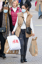 © Licensed to London News Pictures. 04/11/2020.  <br /> Bromley, UK. A lady carrying lots of bags.  Last minute lockdown panic buying shoppers flock to Bromley High Street in South London this afternoon to get food essentials and Christmas gifts. Photo credit:Grant Falvey/LNP