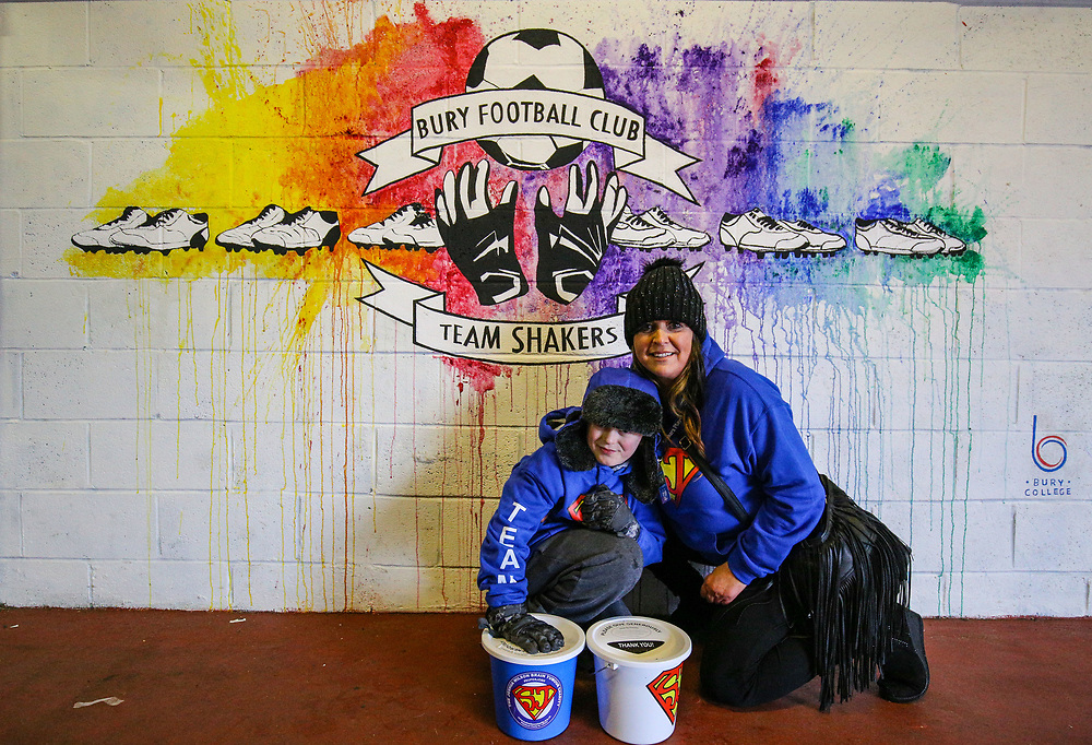 Bury fans pose for a picture inside Gigg Lane, home of Bury FC<br /> <br /> Photographer Alex Dodd/CameraSport<br /> <br /> The EFL Sky Bet League One - Bury v Blackpool - Saturday 3rd February 2018 - Gigg Lane - Bury<br /> <br /> World Copyright © 2018 CameraSport. All rights reserved. 43 Linden Ave. Countesthorpe. Leicester. England. LE8 5PG - Tel: +44 (0) 116 277 4147 - admin@camerasport.com - www.camerasport.com