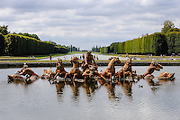 The Palace of Versailles, or simply Versailles, is a royal château close to Paris, France. The Gardens of Versailles with the Apollo Fountain in Bassin d'Apollon and Grand Canal in the background.