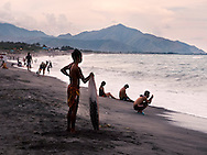 A surfer stands on a beach of San Narciso, Zambales, Central Luzon , Luzon Island, Philippines, Southeast Asia