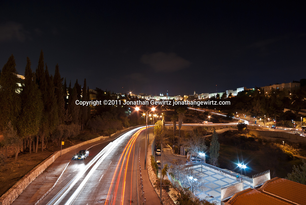 View along the Derech Hevron toward the Jaffa Gate and walls of the Old City of Jerusalem at night. WATERMARKS WILL NOT APPEAR ON PRINTS OR LICENSED IMAGES.